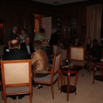 Some guests relaxed and dined in the living room.